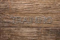在木背景写的训练 免版税库存图片