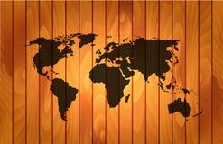 在木背景的世界地图 免版税图库摄影