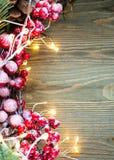 在木背景的左边圣诞装饰与光 图库摄影