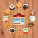 在木背景的快餐产品 库存图片
