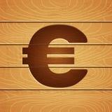 在木背景的欧元 库存照片