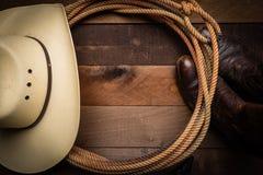 在木背景的牛仔供应 库存照片