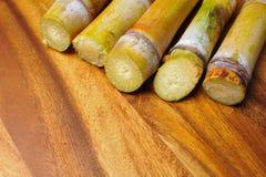 在木背景的甘蔗 库存图片