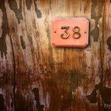 在木背景的第38 免版税库存图片