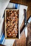 在木背景的自创坚果蛋糕 库存图片