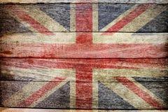 在木背景的英国旗子 免版税库存图片