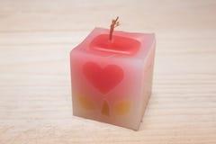 在木背景的蜡烛 库存照片