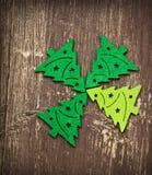在木背景的装饰圣诞树 免版税图库摄影