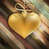 在木背景的金心脏。+ EPS10 免版税库存照片