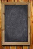 在木背景的黑板 免版税库存图片