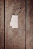 在木背景的价牌标签 免版税库存照片