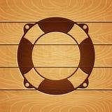在木背景的Lifebuoy 免版税库存图片