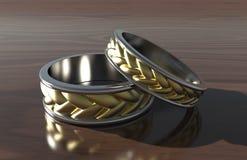在木表上的金戒指 免版税图库摄影