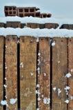 在木调色板的雪 免版税库存照片