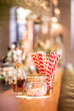在木酒吧间的糖果 免版税库存照片