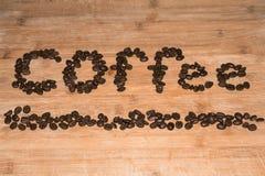 在木头的咖啡豆 库存照片
