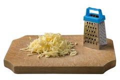 在木头的搓碎干酪与在白色隔绝的一台一点磨丝器 库存图片
