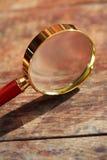 在木头的放大镜 免版税图库摄影