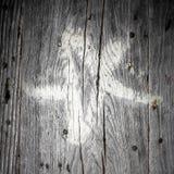 在木头的白色五芒星形 库存图片