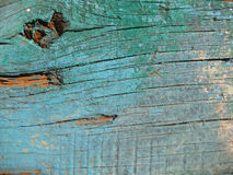在木头的老蓝色油漆 免版税库存照片