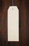 在木质的背景的纸标记 免版税库存照片