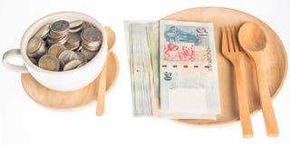 在木头的货币 库存照片