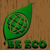 在木backgroung的绿色eco世界标志 库存照片