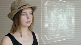 在未来派用户界面概念屏幕上的女孩新闻 图形用户界面- GUI 头显示- HUD 股票视频