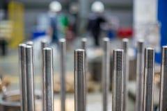 在机制的螺栓在生产大厅里 免版税图库摄影