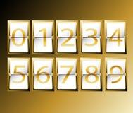 在机场终端时间表显示字体集合金子的数字   免版税库存图片