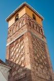 在村庄教会的钟楼的砖砌 库存照片