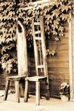 在村庄的门廊的手工制造木椅子 库存图片