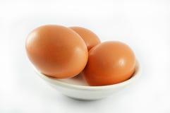 在杯子的三个鸡蛋 免版税库存照片