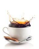在杯子的咖啡飞溅 库存照片