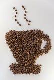 在杯子的形状的咖啡豆 库存照片