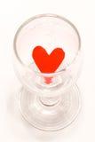 在杯子的红色心脏 库存照片