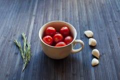 在杯子的蕃茄 免版税库存照片