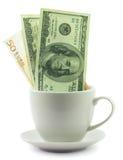 在杯子的金钱 库存图片