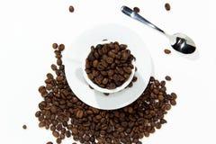在杯的咖啡豆 免版税库存照片