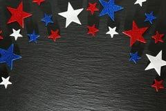 在板岩的红色,白色和蓝星 库存照片