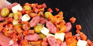 在板岩背景的开胃小菜选择 库存图片