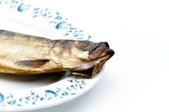 在板材抽烟的鲱鱼 免版税库存图片