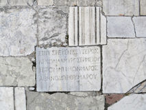 在板材的希腊文化的题字 库存图片