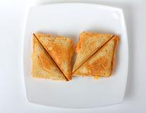 在板材的敬酒的三明治 免版税库存照片