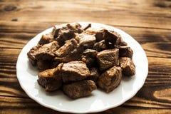 在板材的油煎的肉 库存图片