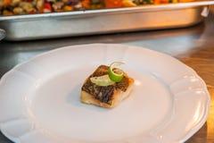 在板材的油煎的鳕鱼 免版税图库摄影