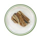 在板材的烟熏鲱鱼内圆角 免版税图库摄影