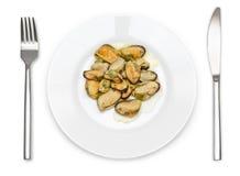 在板材的煮熟的淡菜 免版税图库摄影