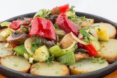 在板材的煮熟的菜 免版税图库摄影