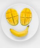 在板材的芒果面孔 免版税图库摄影